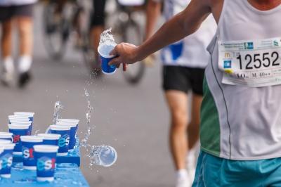 Marathon runner drinking water