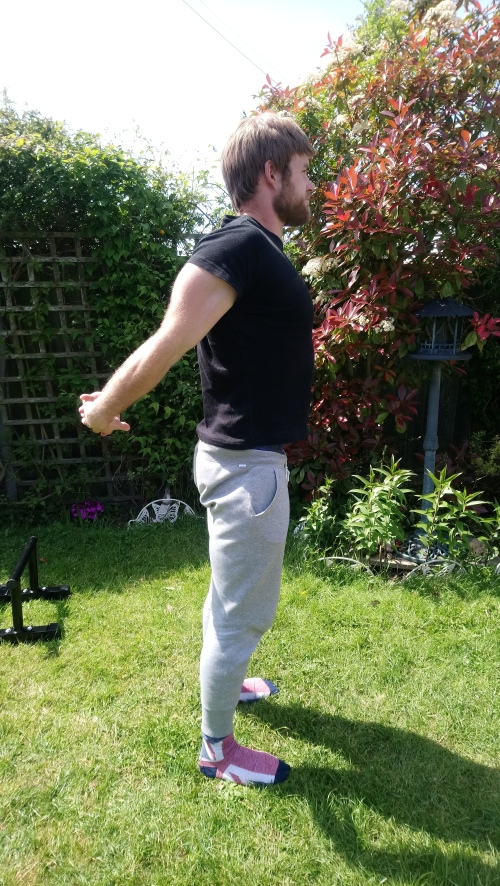 Shoulder extension with hands clasped